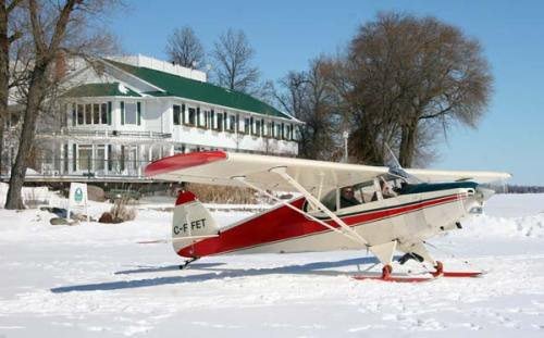small plane on skis at Elmhirst Resort, Ontario