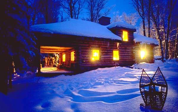 Algonquin Log Cabin in winter near Algonquin Park, Ontario